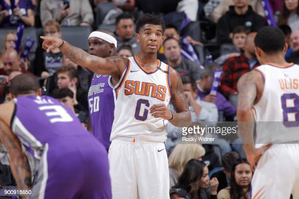 Marquese Chriss of the Phoenix Suns points during the game against the Sacramento Kings on December 29 2017 at Golden 1 Center in Sacramento...