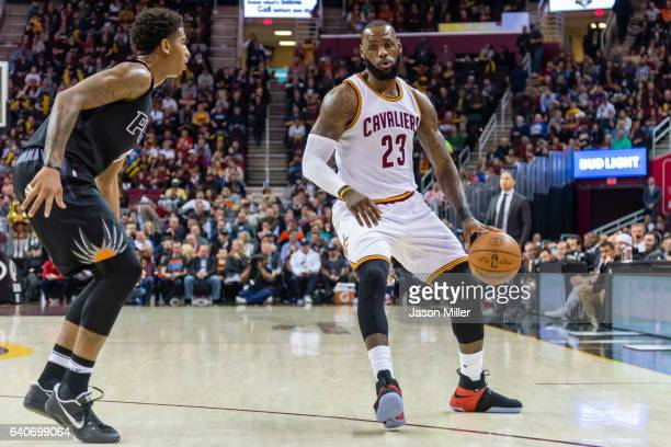 Marquese Chriss of the Phoenix Suns puts pressure on LeBron James of the Cleveland Cavaliers during the first half at Quicken Loans Arena on January...