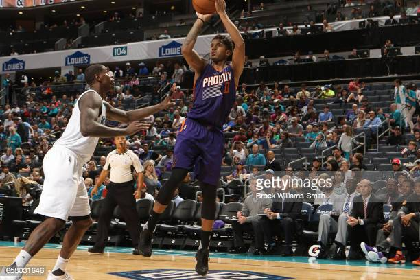 Marquese Chriss of the Phoenix Suns shoots the ball against the Charlotte Hornets on March 26 2017 at Spectrum Center in Charlotte North Carolina...