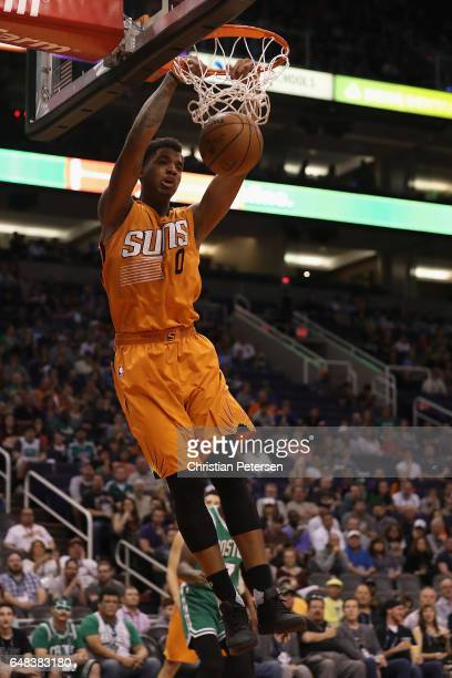 Marquese Chriss of the Phoenix Suns slam dunks the ball against the Boston Celtics during the first half of the NBA game at Talking Stick Resort...