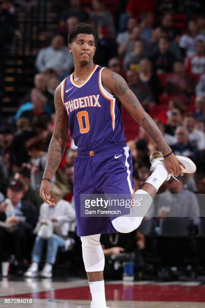 Marquese Chriss of the Phoenix Suns stretches before the game against the Portland Trail Blazers on October 3 2017 at the Moda Center in Portland...