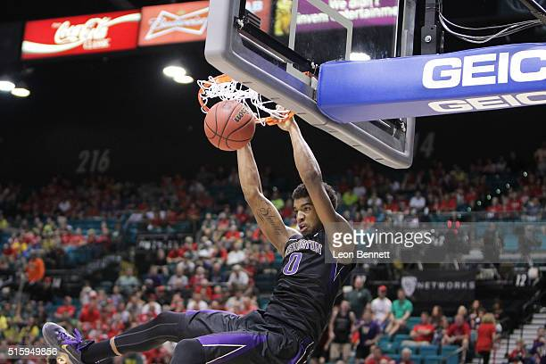 Marquese Chriss of the Washington Huskies dunks the ball for two against the Oregon Ducks during a quarterfinal game of the Pac12 Basketball...