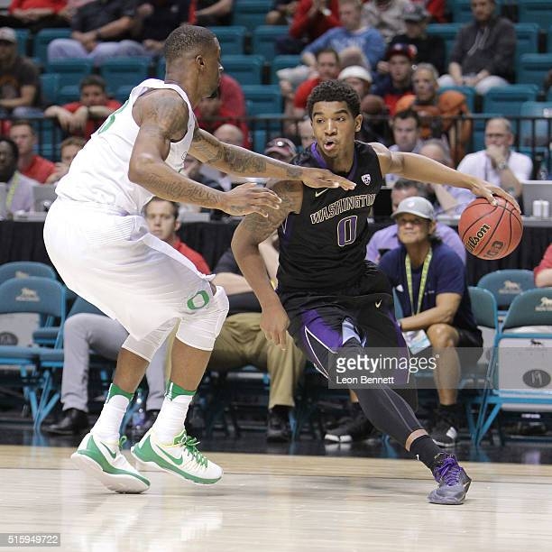 Marquese Chriss of the Washington Huskies handles the ball against Elgin Cook of the Oregon Ducks during a quarterfinal game of the Pac12 Basketball...