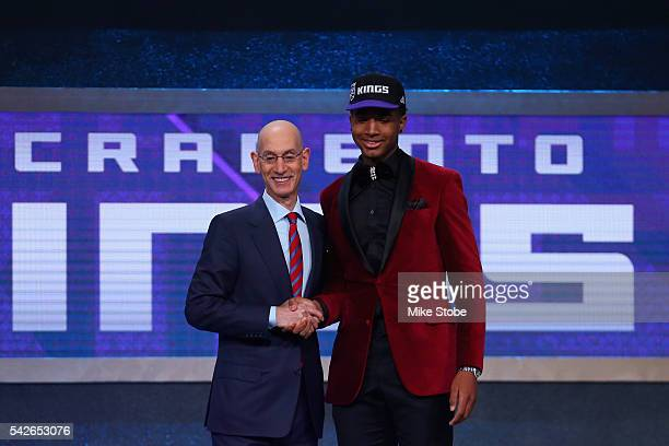 Marquese Chriss poses with Commissioner Adam Silver after being drafted eighth overall by the Sacramento Kings in the first round of the 2016 NBA...