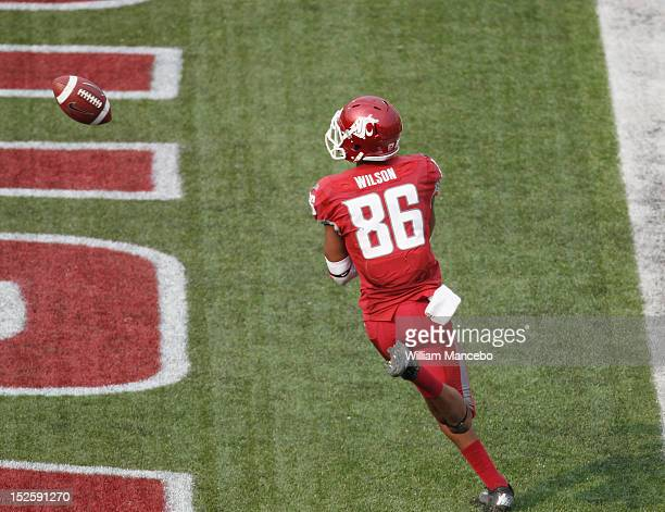 Marquess Wilson of the Washington State Cougars tosses the ball after his 3rd quarter touchdown against the Colorado Buffaloes at Martin Stadium on...