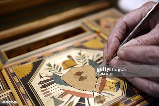 Marquetry inlayer Lison de Caunes is at work in her workshop on March 6 in Paris Straw marquetry is a French tradition that dates back to the 17th...