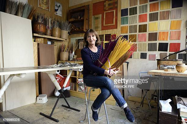 Marquetry inlayer Lison de Caunes poses in her workshop on March 6 in Paris Straw marquetry is a French tradition that dates back to the 17th century...