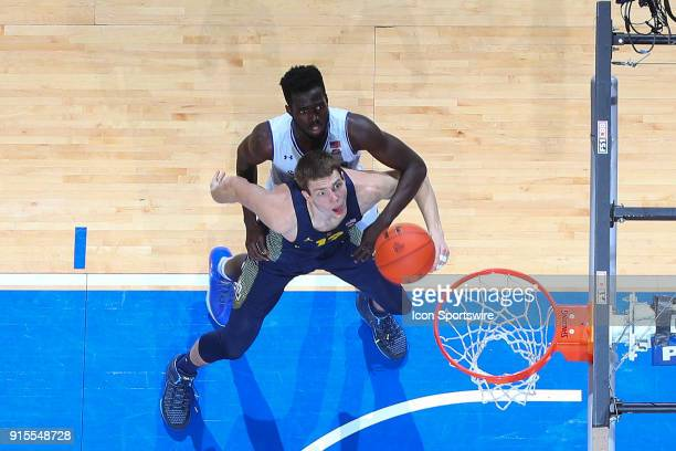 Marquette Golden Eagles center Matt Heldt boxes out Seton Hall Pirates forward Ismael Sanogo for a rebound during the second half of the game between...