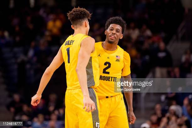 Marquette Golden Eagles forward Brendan Bailey and Marquette Golden Eagles forward Sacar Anim celebrate during a game between the Marquette Golden...