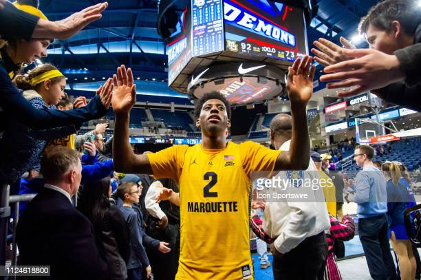 Marquette Golden Eagles forward Sacar Anim celebrates with fans after a game between the Marquette Golden Eagles and the DePaul Blue Demons on...
