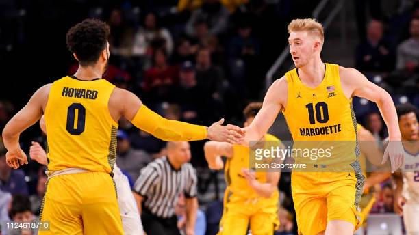 Marquette Golden Eagles forward Sam Hauser celebrates with Marquette Golden Eagles guard Markus Howard during a game between the Marquette Golden...