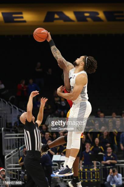 Marquette Golden Eagles forward Theo John wins the opening tip during a game between the Marquette Golden Eagles and the Grambling State Tigers at...