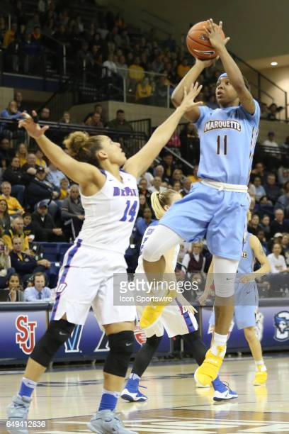 Marquette Golden Eagles guard Allazia Blockton shoots over DePaul Blue Demons guard Jessica January during the Big East Women's Championship Game...