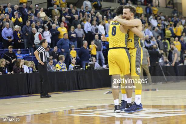 Marquette Golden Eagles guard Andrew Rowsey and Marquette Golden Eagles guard Markus Howard hug during a National Invitation Tournament game between...