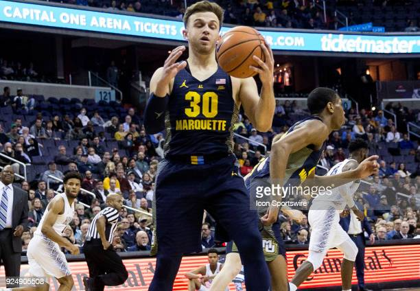 Marquette Golden Eagles guard Andrew Rowsey collects the ball to start an attack during a Big East men's basketball game between the Georgetown Hoyas...