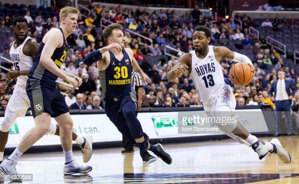 Marquette Golden Eagles guard Andrew Rowsey cuts in to stop Georgetown Hoyas guard Trey Dickerson during a Big East men's basketball game between the...