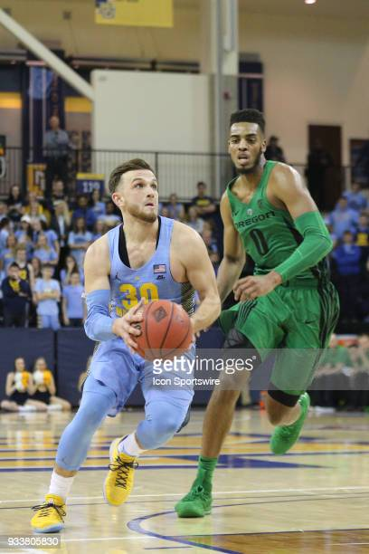 Marquette Golden Eagles guard Andrew Rowsey drives during a National Invitation Tournament game between the Marquette Golden Eagles and the Oregon...