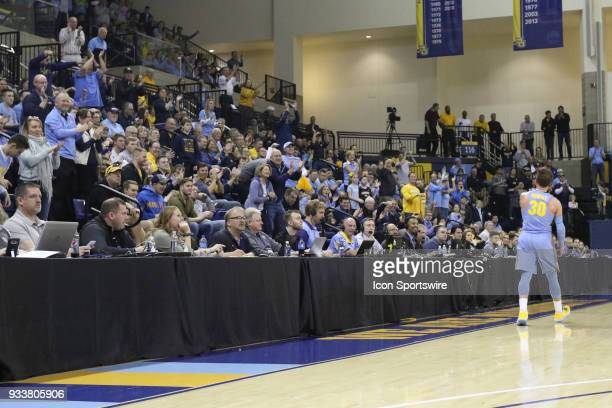 Marquette Golden Eagles guard Andrew Rowsey fires up the crowd during a National Invitation Tournament game between the Marquette Golden Eagles and...