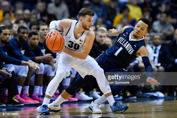 Marquette Golden Eagles guard Andrew Rowsey is defended by Villanova Wildcats guard Jalen Brunson during the game between the Marquette Golden Eagles...
