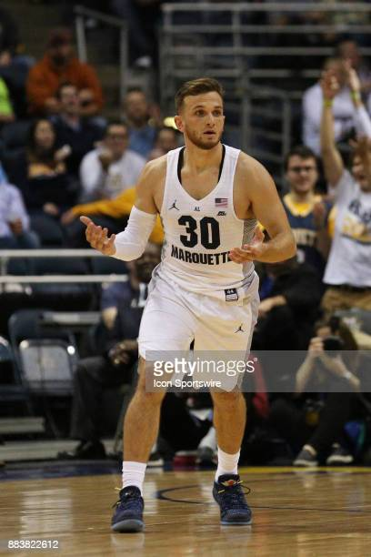 Marquette Golden Eagles guard Andrew Rowsey reacts after making an off balanced shot during a game between the Marquette Golden Eagles and the...