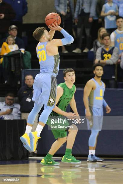 Marquette Golden Eagles guard Andrew Rowsey shoots a three pointer during a National Invitation Tournament game between the Marquette Golden Eagles...