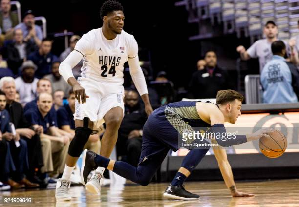 Marquette Golden Eagles guard Andrew Rowsey stumbles while dribbling past Georgetown Hoyas forward Marcus Derrickson during a Big East men's...