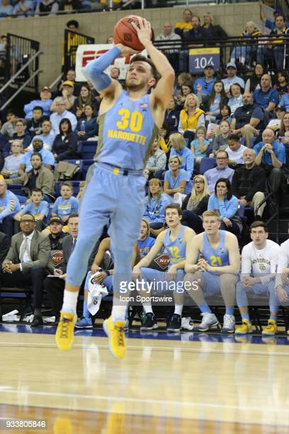 Marquette Golden Eagles guard Andrew Rowsey takes an off balance shot during a National Invitation Tournament game between the Marquette Golden...