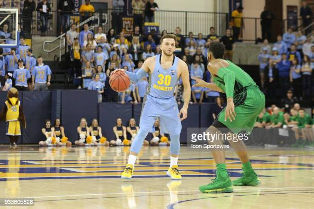 Marquette Golden Eagles guard Andrew Rowsey waits for a play to develop during a National Invitation Tournament game between the Marquette Golden...