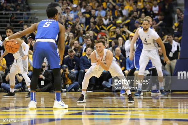 Marquette Golden Eagles guard Andrew Rowsey waits for Creighton Bluejays guard TyShon Alexander to make a move during a game between the Marquette...