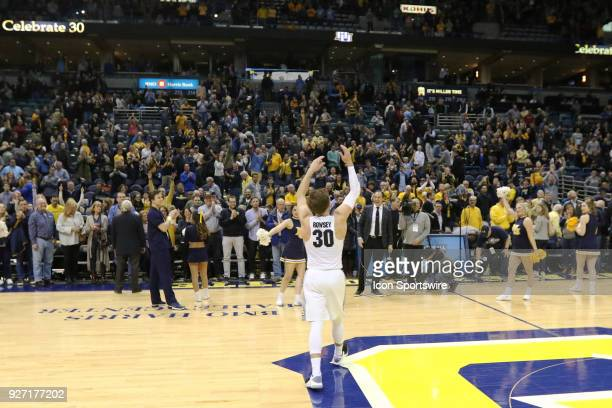 Marquette Golden Eagles guard Andrew Rowsey waves to the crowd following a game between the Marquette Golden Eagles and the Creighton Blue Jays on...