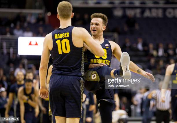 Marquette Golden Eagles guard Andrew Rowsey with Eagles guard Sam Hauser after a crucial three pointer during a Big East men's basketball game...