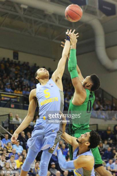 Marquette Golden Eagles guard Greg Elliott and Oregon Ducks forward Troy Brown fight for a rebound during a National Invitation Tournament game...
