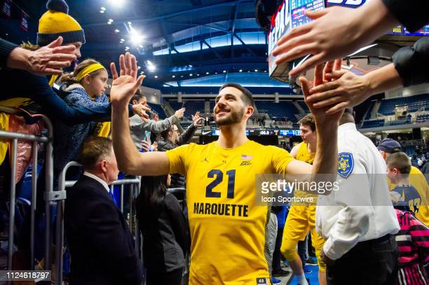 Marquette Golden Eagles guard Joseph Chartouny celebrates with fans after a game between the Marquette Golden Eagles and the DePaul Blue Demons on...