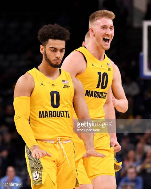 Marquette Golden Eagles guard Markus Howard celebrates his three point shot as forward Sam Hauser reacts during a game between the Marquette Golden...