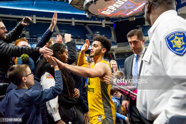 Marquette Golden Eagles guard Markus Howard celebrates with fans after a game between the Marquette Golden Eagles and the DePaul Blue Demons on...