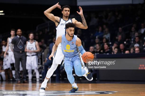 Marquette Golden Eagles guard Markus Howard dribbles past Butler Bulldogs forward Jordan Tucker during the men's college basketball game between the...