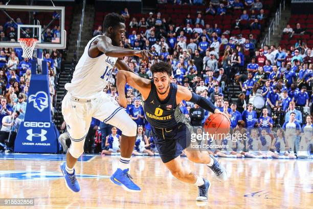 Marquette Golden Eagles guard Markus Howard drives against Seton Hall Pirates forward Ismael Sanogo during the first half of the Collrge Basketball...