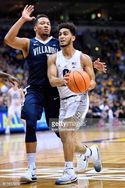 Marquette Golden Eagles guard Markus Howard drives on Villanova Wildcats guard Jalen Brunson during the game between the Marquette Golden Eagles and...