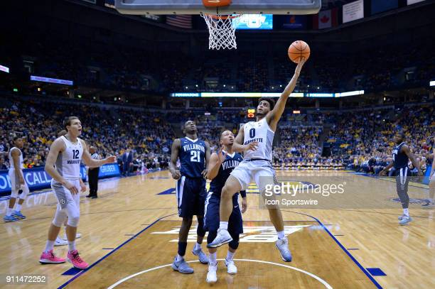 Marquette Golden Eagles guard Markus Howard shoots a layup over Villanova Wildcats guard Jalen Brunson during the game between the Marquette Golden...