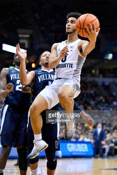 Marquette Golden Eagles guard Markus Howard shoots on Villanova Wildcats guard Jalen Brunson during the game between the Marquette Golden Eagles and...