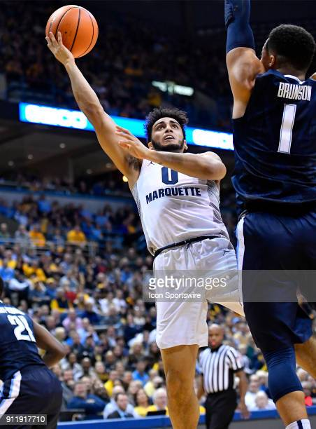 Marquette Golden Eagles guard Markus Howard shoots over Villanova Wildcats guard Jalen Brunson during the game between the Marquette Golden Eagles...