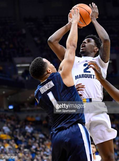 Marquette Golden Eagles guard Sacar Anim shot is contested by Villanova Wildcats guard Jalen Brunson during the game between the Marquette Golden...