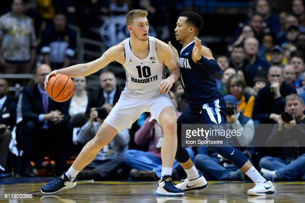 Marquette Golden Eagles guard Sam Hauser backs up Villanova Wildcats guard Jalen Brunson during the game between the Marquette Golden Eagles and the...