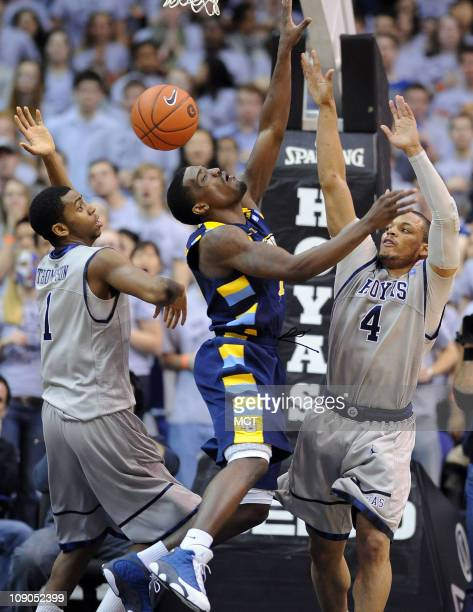 Marquette guard Darius JohnsonOdom center loses the the ball in the lane between Georgetown defenders Chris Wright and forward Hollis Thompson during...