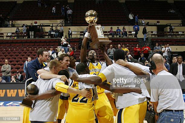 Marquette players celebrate following the annual CBE Classic championship game between Marquette and Duke at Municipal Auditorium in Kansas City...