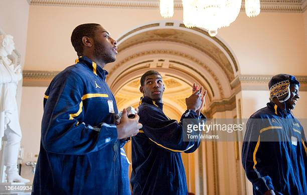 Marquette University basketball players from left DaVante Gardner Jamail Jones and Jamil Wilson take pictures in the Will Rogers Hallway during a...