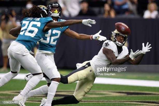 Marquez Callaway of the New Orleans Saints catches a pass for a touchdown over Tyson Campbell of the Jacksonville Jaguars at Caesars Superdome on...