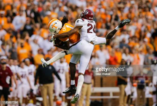 Marquez Callaway of the Tennessee Volunteers catches a pass while defended by Israel Mukamu of the South Carolina Gamecocks at Neyland Stadium on...