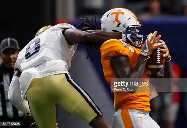 Marquez Callaway of the Tennessee Volunteers is tackled as he pulls in this reception against Step Durham of the Georgia Tech Yellow Jackets at...