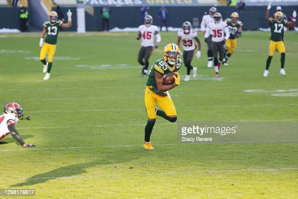 Marquez Valdes-Scantling of the Green Bay Packers completes a touchdown reception in the second quarter against the Tampa Bay Buccaneers during the...